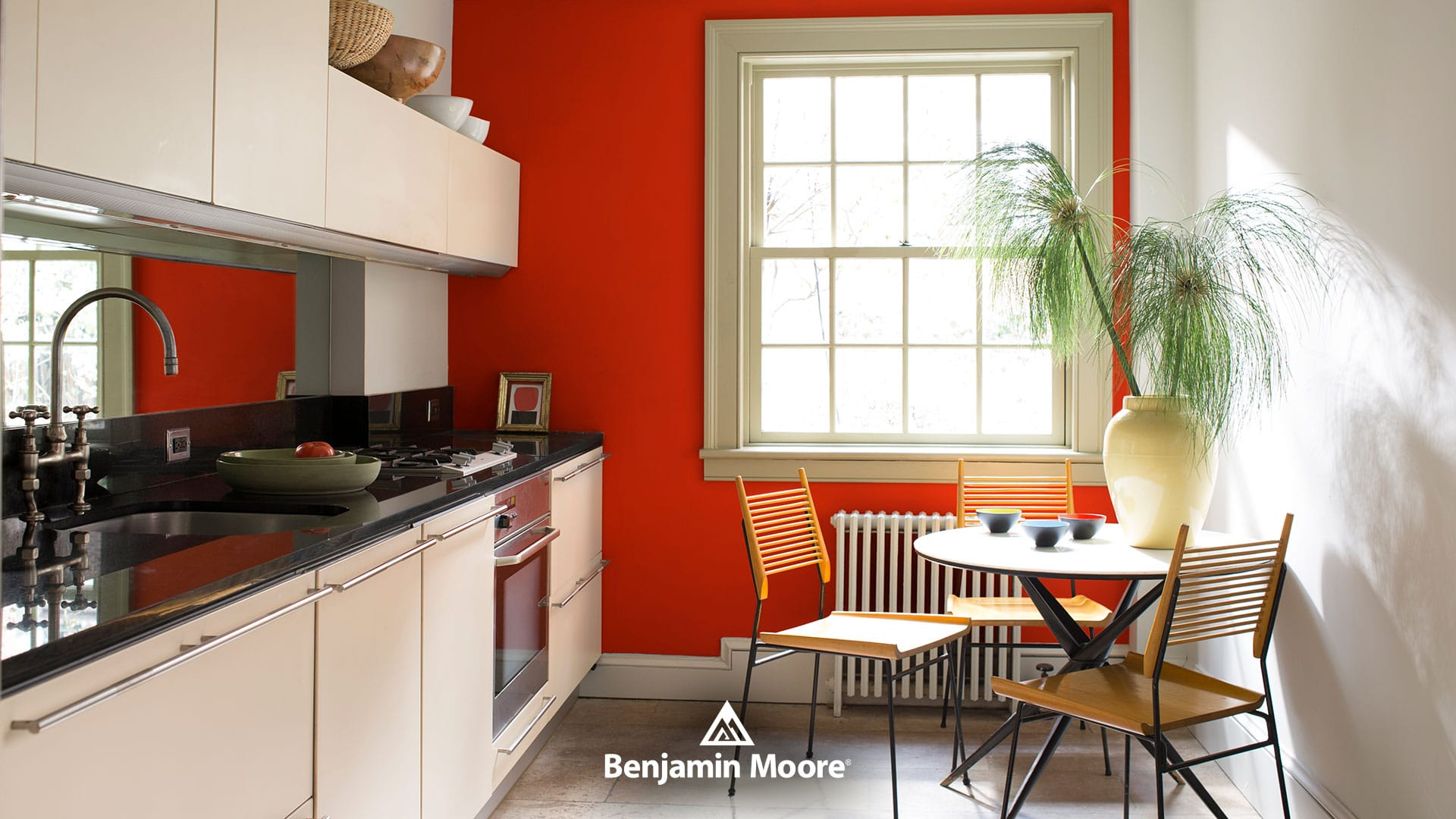 A kitchen in red featuring Benjamin Moore Tomato Tango and Harbor Gray