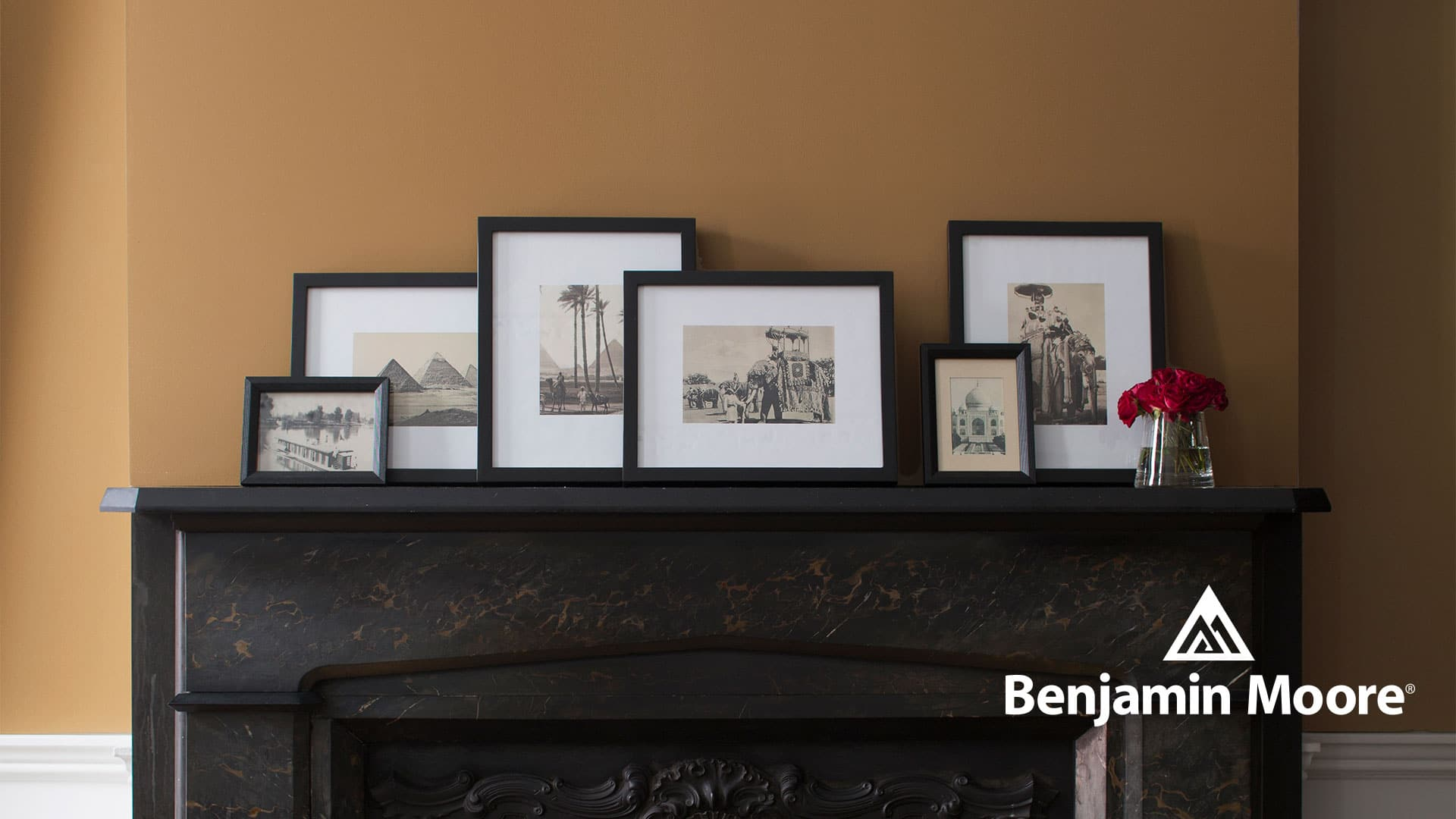 Fireplace mantle featuring a wall in Benjamin Moore Greenfield Pumpkin